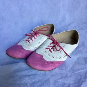 Pink and white Oxford style flats